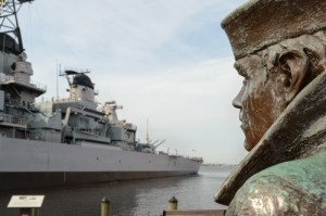 Norfolk, va - October 29: The Lone Sailor statue in Norfolk looks upon the USS Wisconson BB64. This bronze statue created by Stanley Bleifeld is one of twelve statues that are placed in different locations in the U.S.